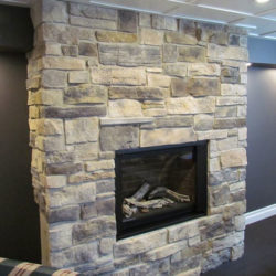 large floor to ceiling stone fireplace