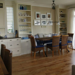 open concept kitchen and dining room, hardwood floors, sliding french doors