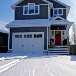 two storey house with self-contained garage, snow on the ground
