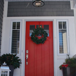 red door with Christmas wreath
