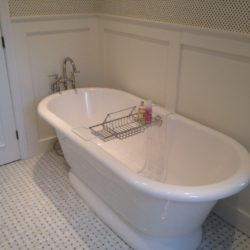 classic style bath tub with floor mounted plumbing