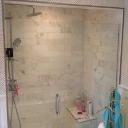 white marble and glass shower enclosure