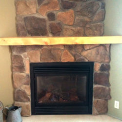Corner situated stone fireplace