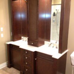 double sink vanity, dark brown wood with white sinks