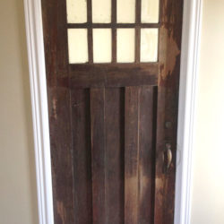 Wooden door with 8 panel glass window.