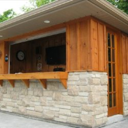 Pool shed with built in bar. Wood and stone construction.
